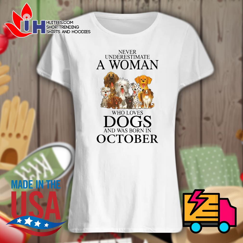 Never underestimate a woman who loves dogs and was born in October s Ladies t-shirt