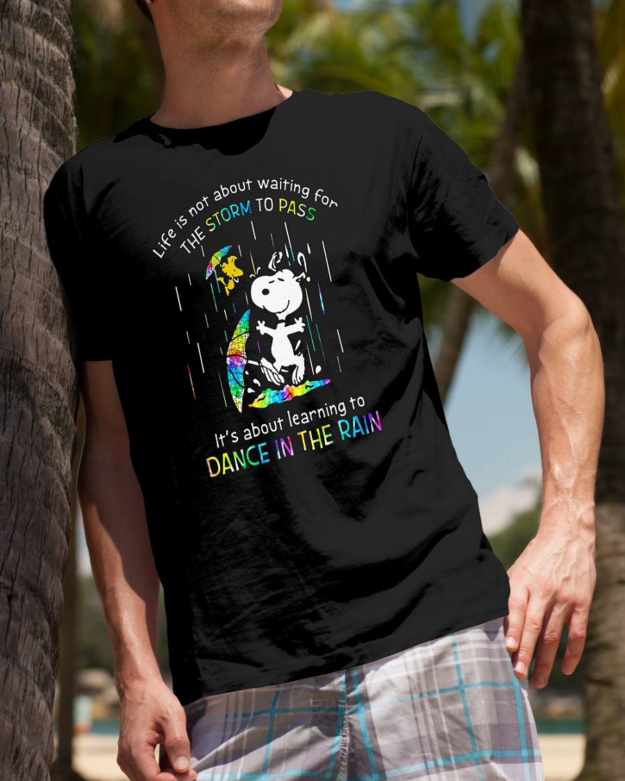 Snoopy autism life is not about waiting for the storm to pass it's about learning to dance in the rain shirt
