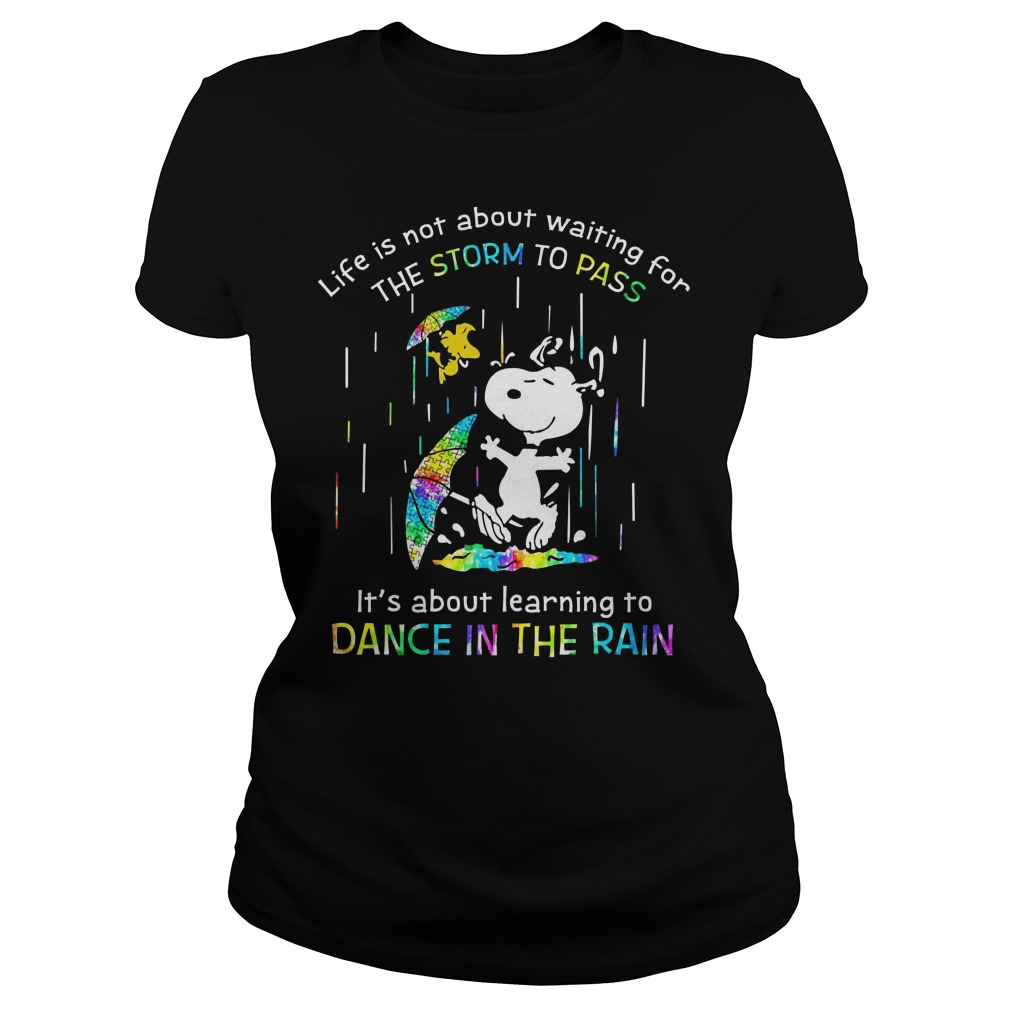 Snoopy autism life is not about waiting for the storm to pass it's about learning to dance in the rain Ladies t-shirt