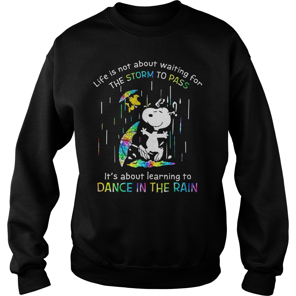 Snoopy autism life is not about waiting for the storm to pass it's about learning to dance in the rain Sweater